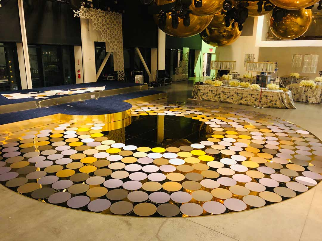 round mirrored dance floor with big circle decals in rows